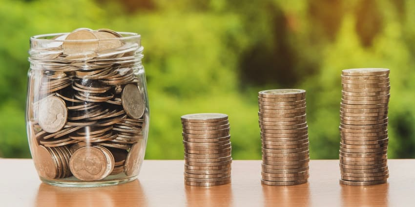 jar of coins and pile of coins investing